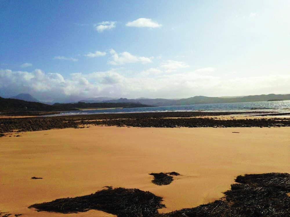 The beach at Gairloch on the North West coast of Scotland - A perfect stop on a 7 day motorhome itinerary!