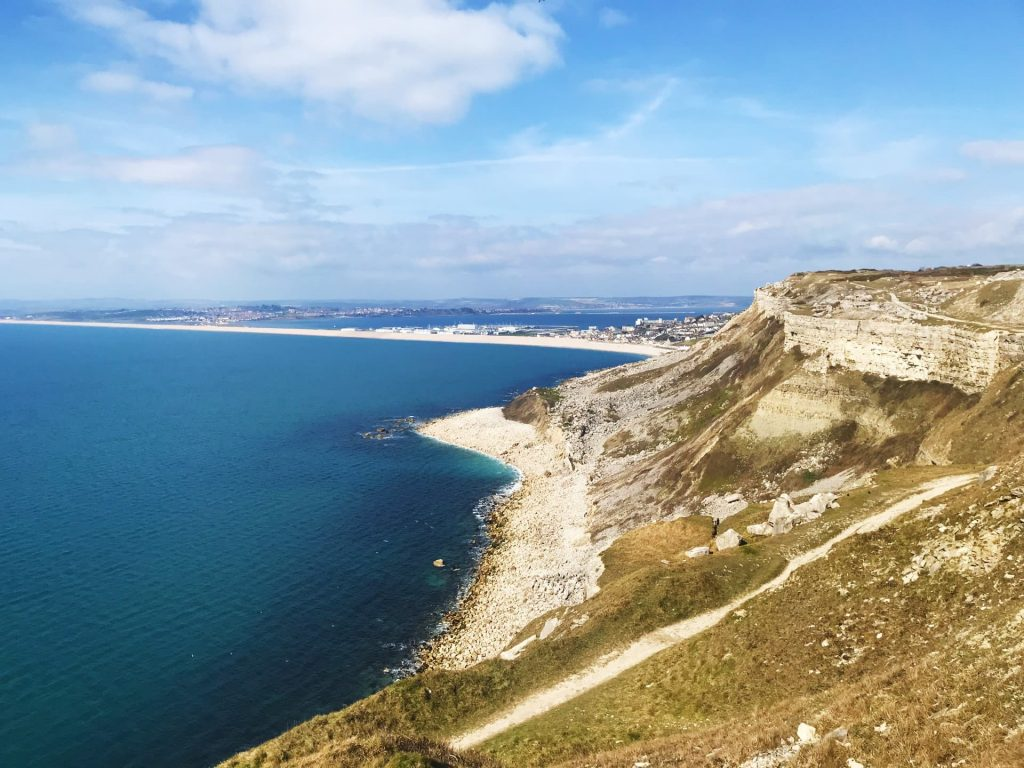 The view of Chesil Beach and the Jurassic Coast from Portland, Dorset, UK - One of the unique places to visit in Europe!