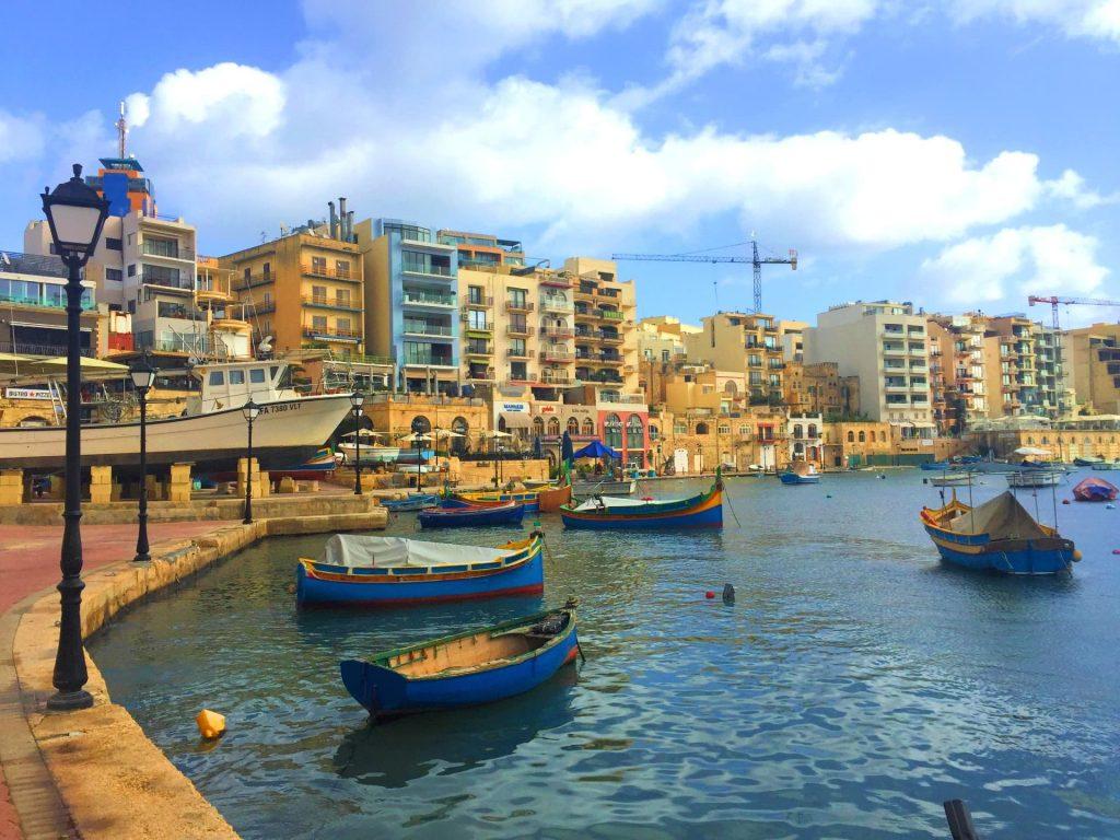 Traditional Maltese Luzzu Fishing Boats on Spinola Bay, St Julians, Malta